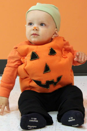 As part of the Care.com Halloween costume series turn your kid into an orange gourd in 3 easy steps.  sc 1 st  Care.com & How To Make An Easy Pumpkin Costume For Kids - Care.com