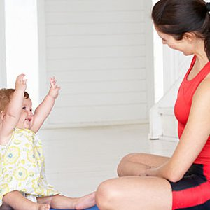 7 mommy and me yoga poses you can do at home  care
