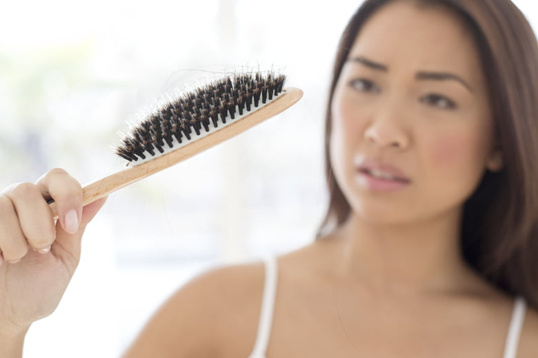 when does postpartum hair loss slow down